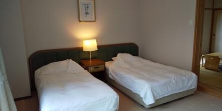 和洋室のベッドスペース/コンドミニアムホテル 山麓